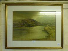 A framed and glazed watercolour of mountainous lake scene signed Caulkin