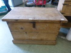 A 19th century pine box with iron carry handles and lock