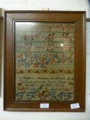 A framed and glazed sampler dated 1845