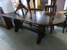 A modern oak drop leaf dinning table with trestle support