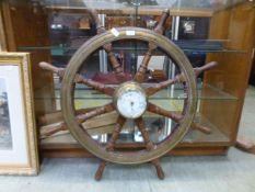 A barometer mounted on a ships wheel A/F
