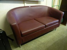 A wine coloured leatherette upholstered two seat settee