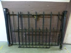 A black painted iron double gate