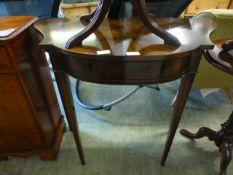 A reproduction mahogany and banded single drawer hall table