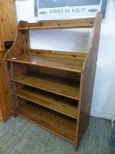 A modern pine adjustable bookcase