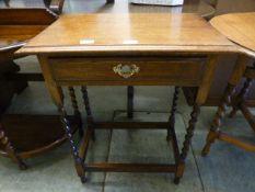 An early 20th century oak single drawer side table
