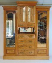 An Edwardian walnut wardrobe,