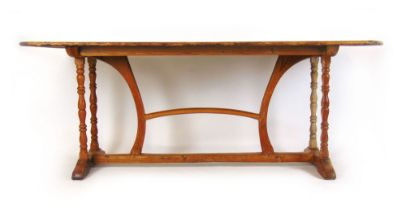 A 19th century and later pine kitchen table,
