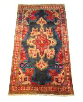 A handwoven Persian wool rug,