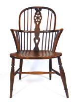 An early 19th century elm, beech and fruit wood Windsor chair, h. 100 cm, w. 52 cm, d.