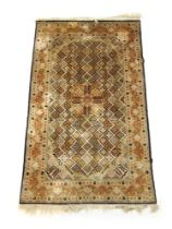 A handwoven Indian silk rug,