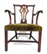 A Georgian mahogany open arm chair, the pierced splat and carved ,