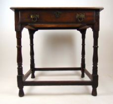 An early 18th century and later oak single drawer side table, on turned legs united by stretchers,