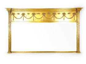 A reproduction neoclassical style giltwood over mantle mirror,