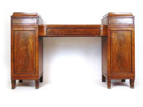 A Regency mahogany, ebony and rosewood cross banded twin pedestal sideboard,