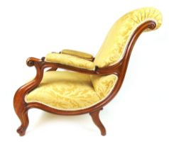 A Victorian walnut open arm chair upholstered in a gold floral fabric,