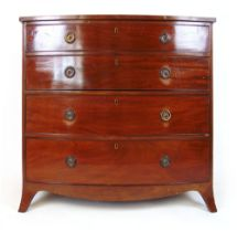 A late 18th century mahogany and boxwood strung bow front chest of four long drawers on splay feet,