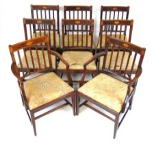 A set of eight (6+2) Edwardian mahogany, satinwood banded and marquetry dining chairs,