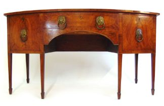 An early 19th century mahogany and boxwood strung bow front sideboard,