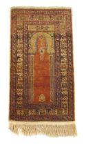 A handwoven Turkish prayer rug,
