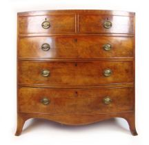A late 18th century mahogany bow front chest of two short over three long drawers on splay feet, h.