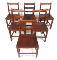 A set of five early 19th century elm and walnut dining chairs,