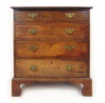 An 18th century oak chest of four long drawers on bracket feet, 88 cm, w. 83 cm, d.