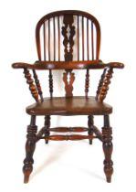 A 19th century elm Windsor chair,