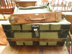 An early 20th century metal bound travelling trunk along with a bag