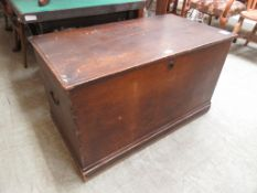 A 19th century scumbled pine travelling trunk