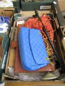 A tray containing a blue handbag, briefcase, jewellery stand, tie backs, cup hooks etc.