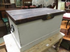 An early 20th century and later travelling trunk