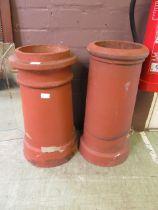 Two terracotta chimney pots