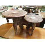 Two eastern carved wood collapsible occasional tables