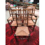 A set of six reproduction beech framed dining chairs with sea grass seat