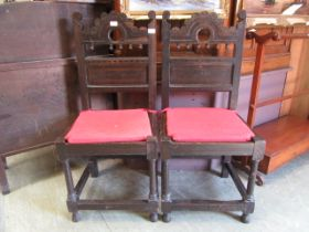 A pair of late 17th century style oak and inlaid back stools
