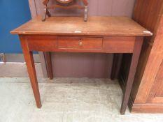 An 18th century oak single drawer side table
