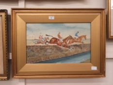 A framed and glazed watercolour of horse racing scene signed J.