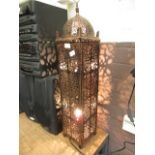 An eastern style pierced metal lamp