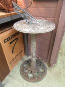 A cast metal sundial