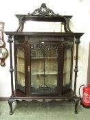 An early 20th century walnut display cabinet,