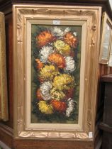 A framed oil on canvas of chrysanthemums signed bottom right