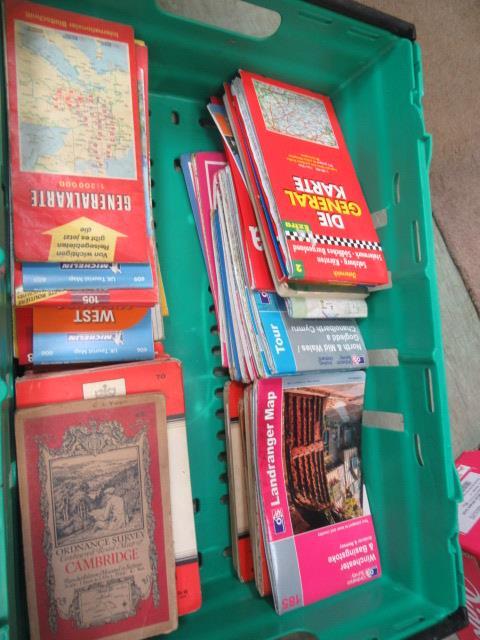 A carton containing a quantity of Ordnance Survey maps etc.