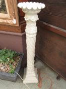 A moulded floor standing candle stand