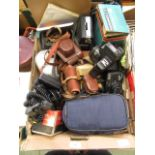A tray of assorted cameras and other photography equipment