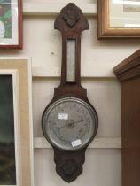 An early 20th century oak banjo barometer