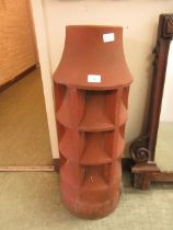 A terracotta chimney pot