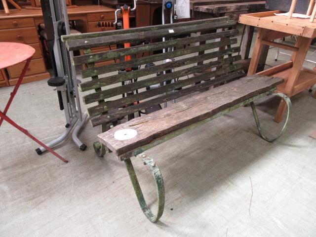 A late 19th century metalwork framed garden bench