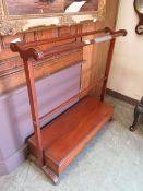 An early 19th century mahogany towel rail with slipper box under