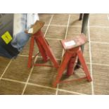 A pair of red axle stands